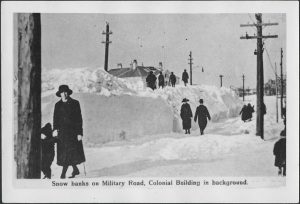 Photo Credit: the Rooms Provincial Archives: A 35-61; Snow Banks on Military Road, Colonial Building in Background