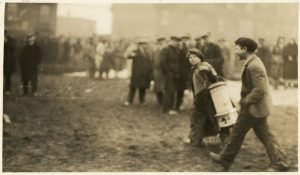 Photo Credit: The Rooms Provincial Archives: A 2-167; A boy removes heater during the riot at the Colonial Building