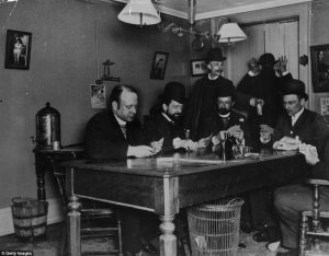 "Journalists drinking and playing cards in the "" Reporters Room""  in the Colonial Building."