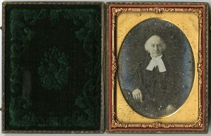 Photo Credit: The Rooms SP 1; Portrait of elderly man in cravat and gown (1860 and 1880] Daguerreotype portraiture was popular in Newfoundland in the 1840's.