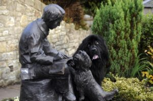 Photo Credit: Paddy the Newfoundland checks out the statue of Robert Louis Stevenson. Picture: Greg Macvea for The Scotsman. Robert Louis Stevenson was born on November 13, 1850.