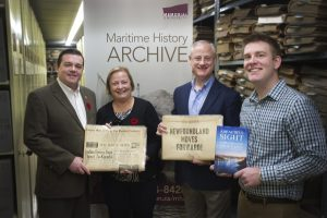 All of the digitized oral histories in the book have been donated to the Maritime History Archive (MHA). Pictured from left to right are Russ Carrigan, chairperson, board of directors, St. John's Port Authority; Heather Wareham, archivist, MHA; Sean Hanrahan, president and CEO, SJPA; and Allan Byrne, editor, A Beautiful Sight.