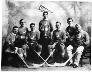 Photo Credit: The Rooms Provincial Archives: The Crescents Hockey Team was considered the best team in Newfoundland at the outbreak of the Great War in 1914. The team signed up almost to a man. Photo Number: 1.26.01.061 Left to right: E. Townshend, Don Trapnell, Will Herder, C. Tessier, George Marshall, Gus Herder and Ralph Burnham.
