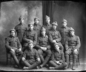 "Photo Credit: The Rooms Provincial Archives: F25. Newfoundland soldiers wearing ""woolen helmets."" Can you identify any of these Newfoundland soldiers?"